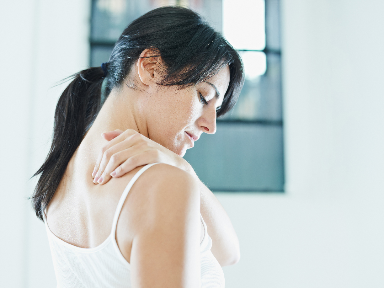woman massaging neck. Side view, copy space